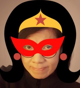A superheroine with heroic mask and wonder woman crown
